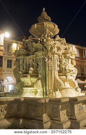 Cesena (Emilia Romagna Italy): the monumental fountain in the main square of the city at evening