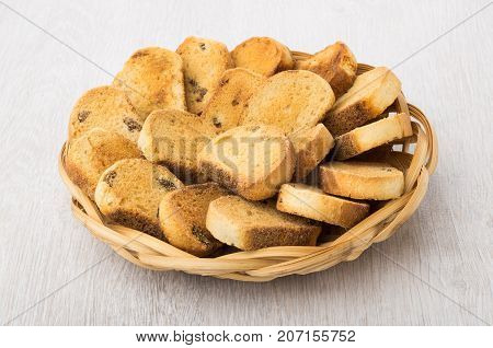 Rusks With Raisin In Wicker Basket On Table