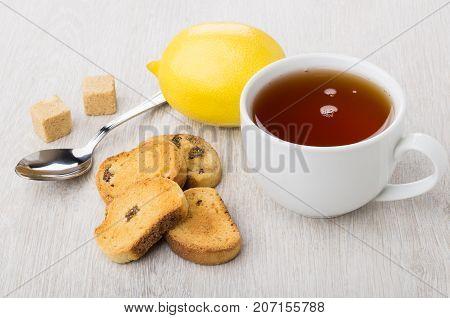 Rusks With Raisin, Tea, Lemon, Lumpy Sugar And Teaspoon