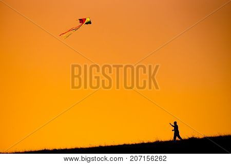 Silhouette Of People Flying A Kite Top Of Mountain Sunset Evoke Emotion Happy Memories.  Doi Mon Jon