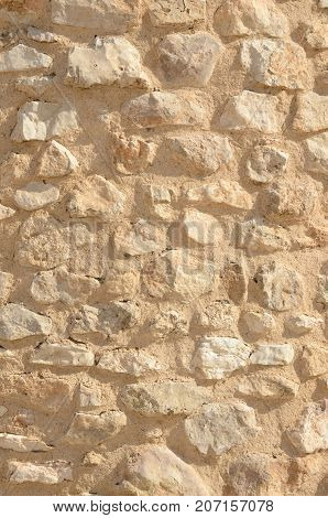 Background of stone on wall of windmill in Belmonte a village in the province of Cuenca Castile-La Mancha Spain.