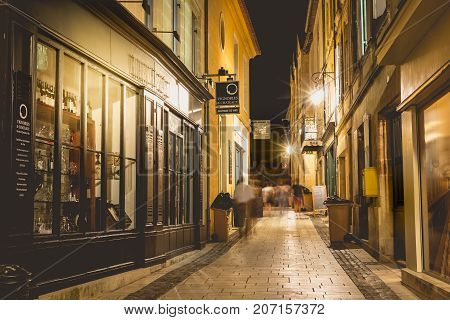 Small Street Of The French Town Of Saint Emilion By Night