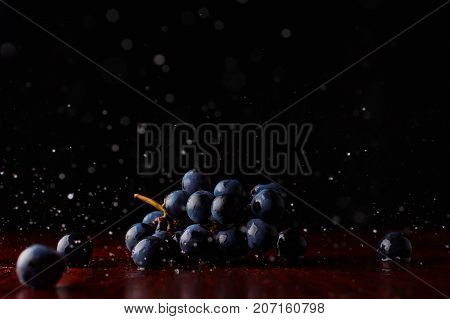 Bunch of fresh red grapes splash movement fruit, grocery, harvest, health, ingredient, bluegrapes, darkgrapes, drink fall grapecluster nature