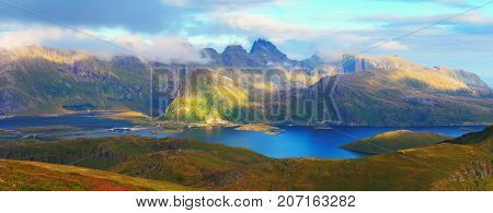 Panoramic view of Lofoten islands in Norway. Sunny nature of Norway. Summer landscape of Norwegian mountains.