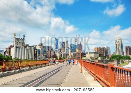 MINNEAPOLIS - JUNE 14: Downtown Minneapolis as seen from the famous stone arch bridge on June 14 2017 in Minneapolis MN.