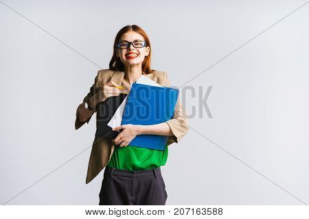 smiling secretary girl holding folders and files in hands