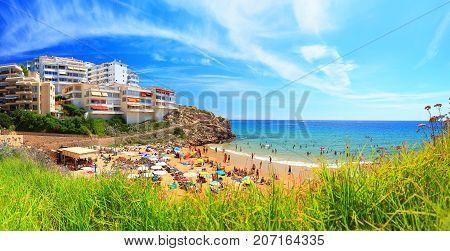 Costa dorada resort on a sunny day. Salou spanish resort town in July. Beautiful panorama of summer catalonia resort.