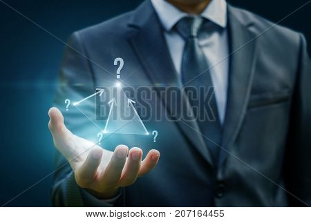 In The Hands Of A Businessman A Complex Pyramid Of Questions.