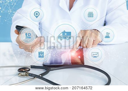 Doctor Shows The Medical Machine Icon On The Screen.