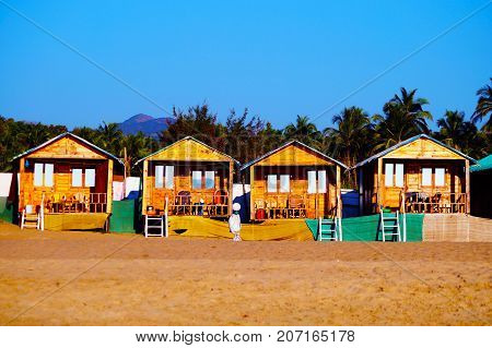 Cozy private resort (bungalows) on the beach, Agonda beach, South Goa. Colorful beach huts.