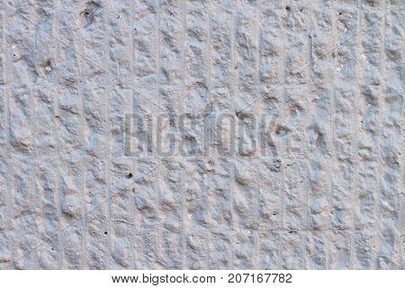 Wavy texture of white concrete convex wall