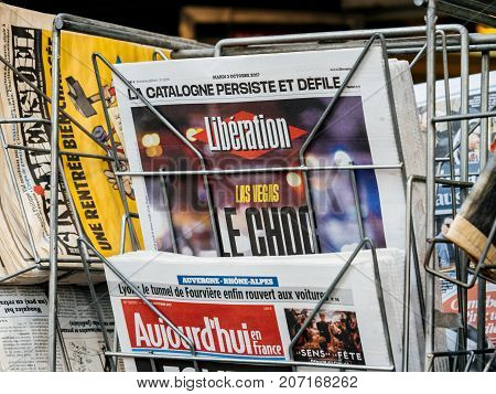 PARIS FRANCE - OCT 3 2017: Liberation French newspaper with socking title and photo at press kiosk about the 2017 Las Vegas Strip shooting in United States with about 60 fatalities and 527 injuries