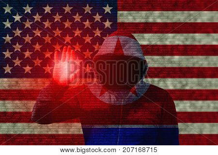 A north korean flag hooded hacker touching the flag of the usa with computercode texture cyberattack concept