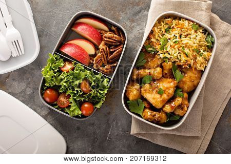 Lunch boxes with food ready to go for work or school, ahead meal preparation or dieting concept