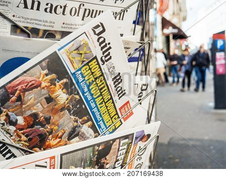 PARIS FRANCE - OCT 3 2017: City scene with Daily Mail newspaper at kiosk with socking title and photo at press kiosk about the 2017 Las Vegas Strip shooting in United States with about 60 fatalities and 527 injuries
