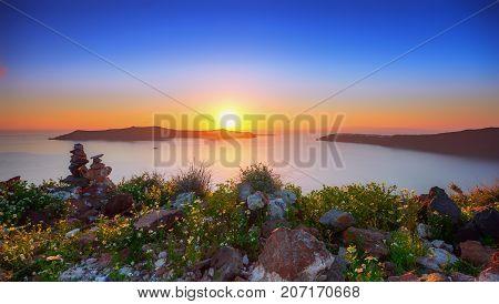 Amazing sunset at Panagia Theoskepasti, on the Skaros rock at Imerovigli, Santorini, Crete, Greece.