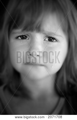 Little Girl Crying With Tears On Cheeks