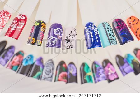 Finger nail art design samples. Beautiful nail art on plastic tips. Manicure nail color design samples.