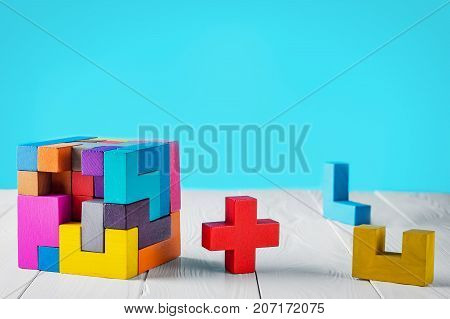 Concept of decision making process. Concept of creative logical thinking. Different geometric shapes wooden blocks on white wooden background copy space. Geometric shapes in different colors.