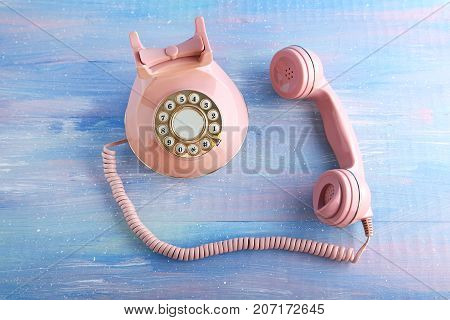 Pink Retro Telephone On Blue Wooden Table