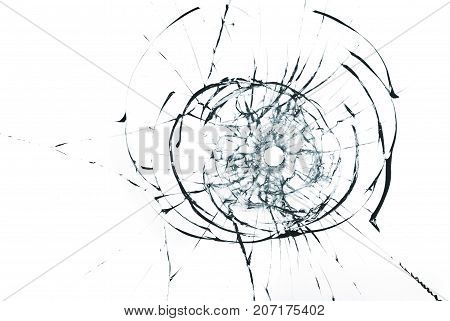 bullet hole in glass closeup on white background