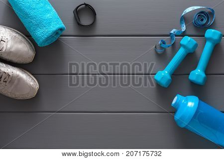 Fitness background, blue sport equipment for training, copy space, top view. Weightloss, healthy lifestyle concept