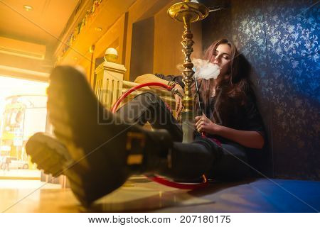 Beautiful Woman Smoke Hookah On Floor