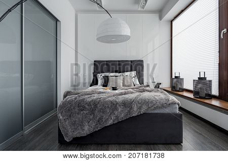 Bedroom With Modern Lamp