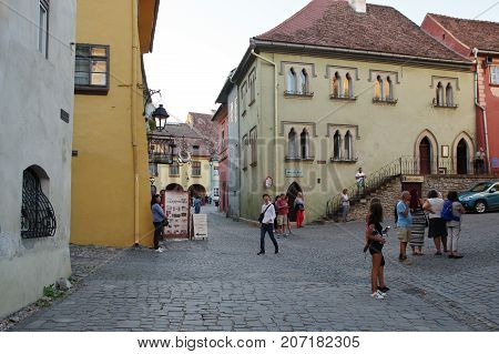 Sighisoara Transylvania Romania - September 11 2017: medieval old town surrounded by defensive walls. Buildings typical for the region.