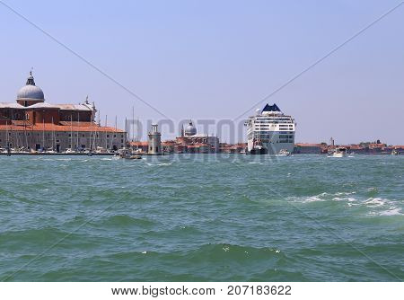 Italy Venice Cruise Ship Driven By The Tugboat On The Giudecca C