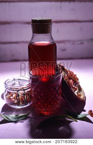 Grant and pomegranate juice on the table