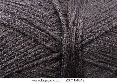 A super close up image of black yarn