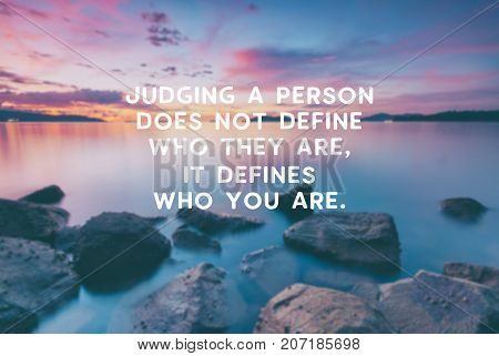 Inspirational and motivational quotes - Judging a person does not define who they are it defines who you are. Retro styles and blurry background.