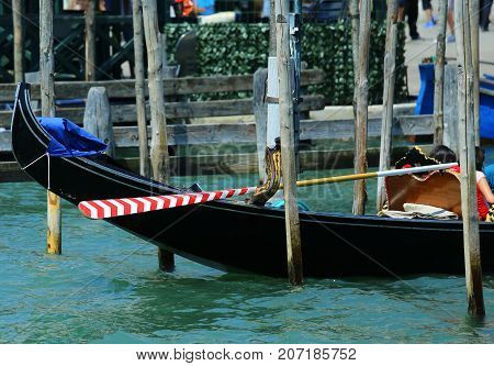 White And Red Oar Of A Gondola In Venice