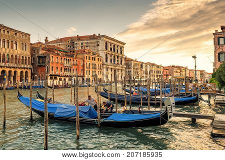 Venice, Italy - May 17, 2017: The famous Grand Canal with gondolas at sunset. Grand Canal is one of the major water-traffic corridors and tourist attraction in Venice.