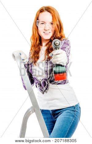 Vertical Portrait Of A Woman On A Stepladder With A Drill Isolated