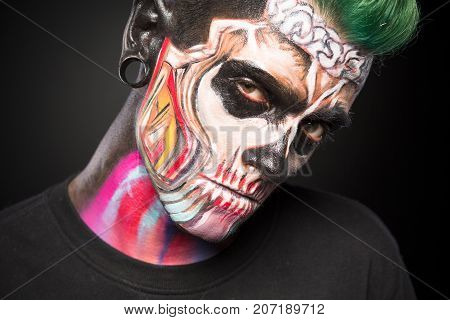 Bright skeleton makeup on mans face. Mystical face art concept, professiona face painting.