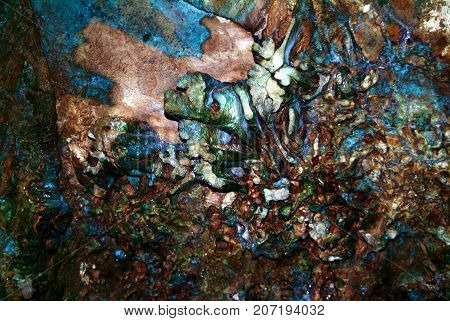 A colorful abstract cave formation created by water and minerals over eons,