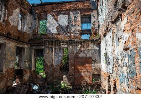 Interior of ruined, abandoned apartment residential building after earthquake or war. Ruins of abandoned ruined house, toned