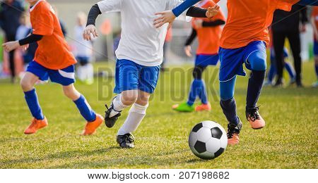 Running Children Football Soccer Players with Ball. Footballers Kicking Football Match on the Pitch. Young Teen Soccer Game. Youth Sport Background
