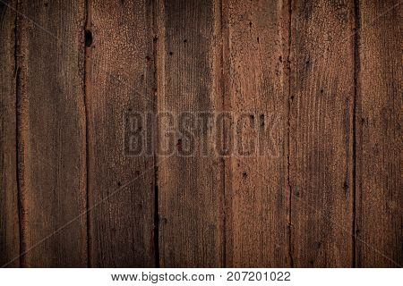 ark old wooden table texture backgroundNatural detailed plank photo texture. Texture in warm red and dark brown tones. Old wooden vintage background closeup for design with vignette