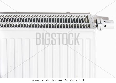 Thermostat turned off to save energy. White radiator in an apartment.