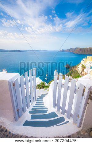 A traditional symmetric door yard, Ia, Santorini, Greece. Honeymoon summer aegean cycladic background, serenity, tranquility.