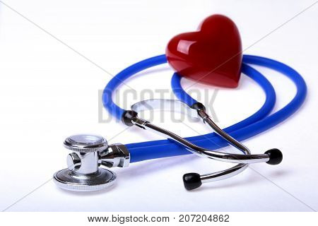 medical stethoscope and red heart isolated on white background. selective focus