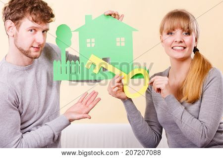 Cheerful Couple Holding Cutouts.