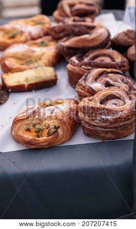 Cinnamon buns baked fresh and in the window of a bakery