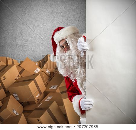 Santa Claus ready to deliver a lot of presents for Christmas