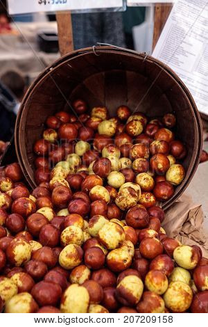 Bushel of brown ziziphus jujube dates also called red date or Chinese date sold at a farmers market
