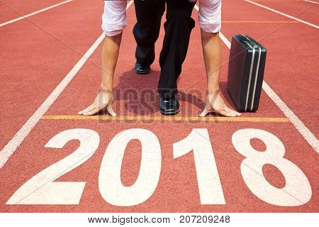 businessman ready to run and 2018 new year concept