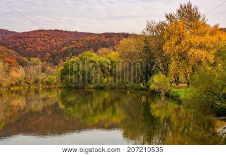 Landscape With Calm River In Autumn